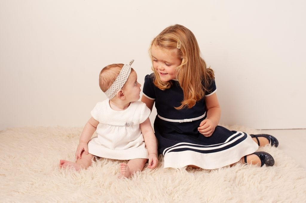 sisters, sailor dress, sparkly shoes, polka dot headband, white, chislehurst, london,