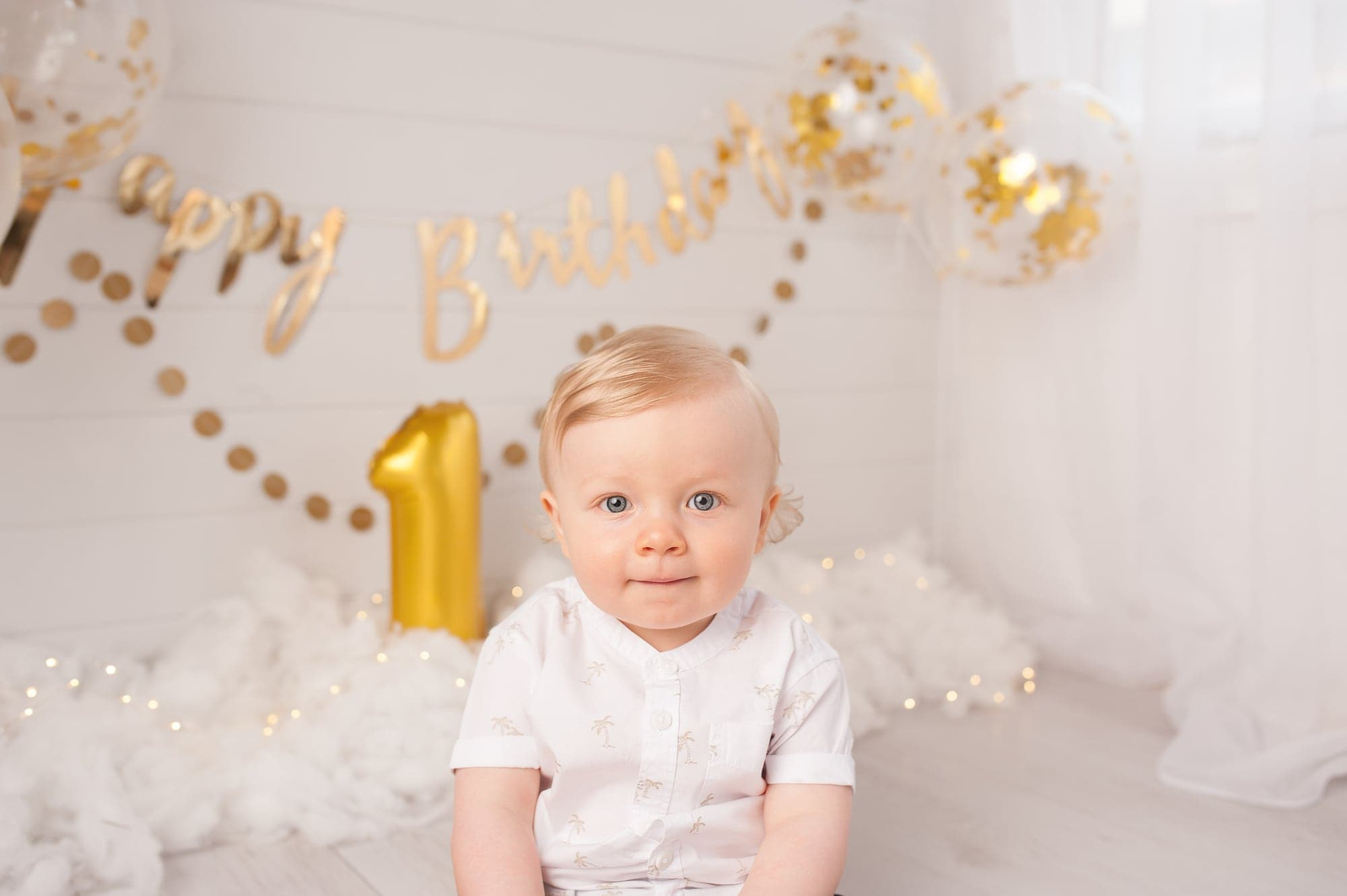 First Birthday, Gold, palm tree shirt, white shirt, clouds, twinkle, ginger ray garland, blonde haired boy, blue eyes, confetti balloons, kent