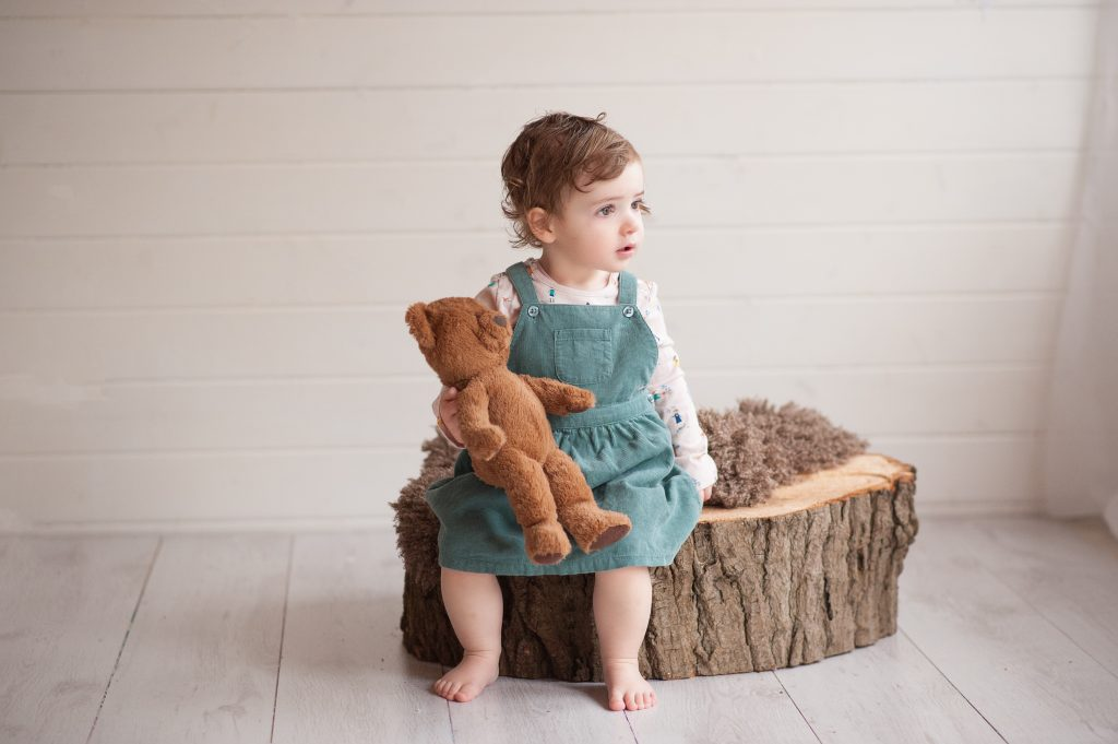 brown bear, log, dungaree dress, fluffy, simple, natural portrait, little girl, bromley, london,