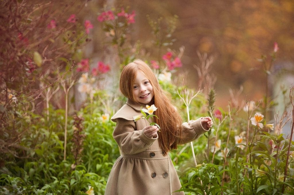 wild flowers, trench coat, red head, pink flowers, autumn, outdoor photographer, kids photographer near me, bromley
