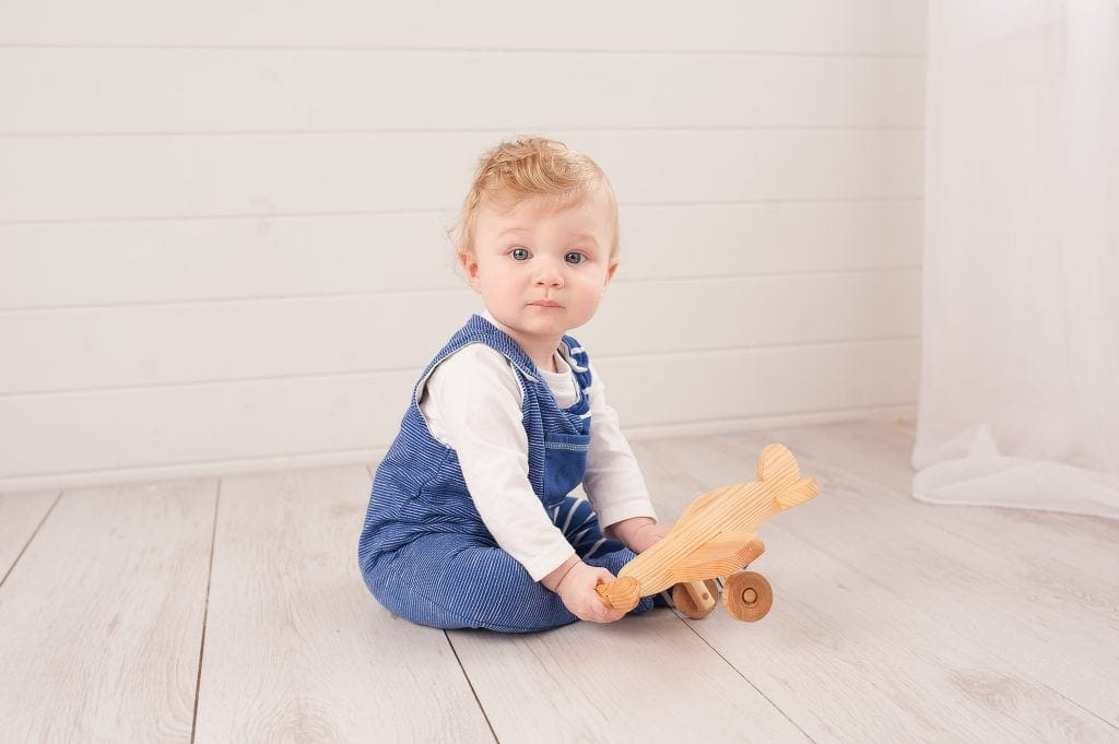 wooden plane, dungarees, blue, white, blonde boy, blue eyes, kids photos, chislehurst, kent,