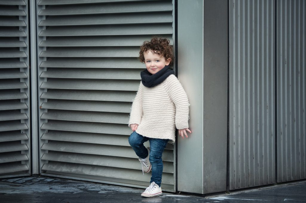 little boy, curly hair, knitted jumper, london, converse, snood, tower bridge, slate grey