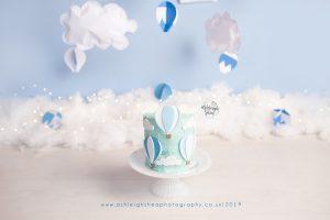 hot air balloon, bromley, cake smash, light blue, hot air balloon cake smash, clouds, bespoke, boys cake smash, ashleigh shea photography, bromley, kent
