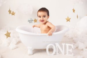 one, first birthday smash, bath tub, white clouds, stars, gold, ashleigh shea photography, cake smash near me, kent, london