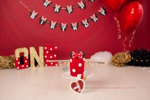 miss mouse, minnie mouse, cake smash, bromley, kent, ashleigh shea photography, red, gold, white, birthday cake smash, pom pom