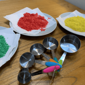 drying out rainbow rice, measuring spoons, toddler fun,