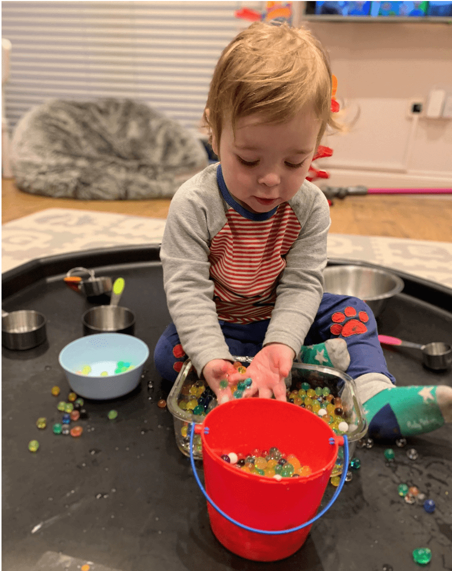 3 of 3 Sensory Play Activities for Your Toddler, water beads, buckets, toddler fun