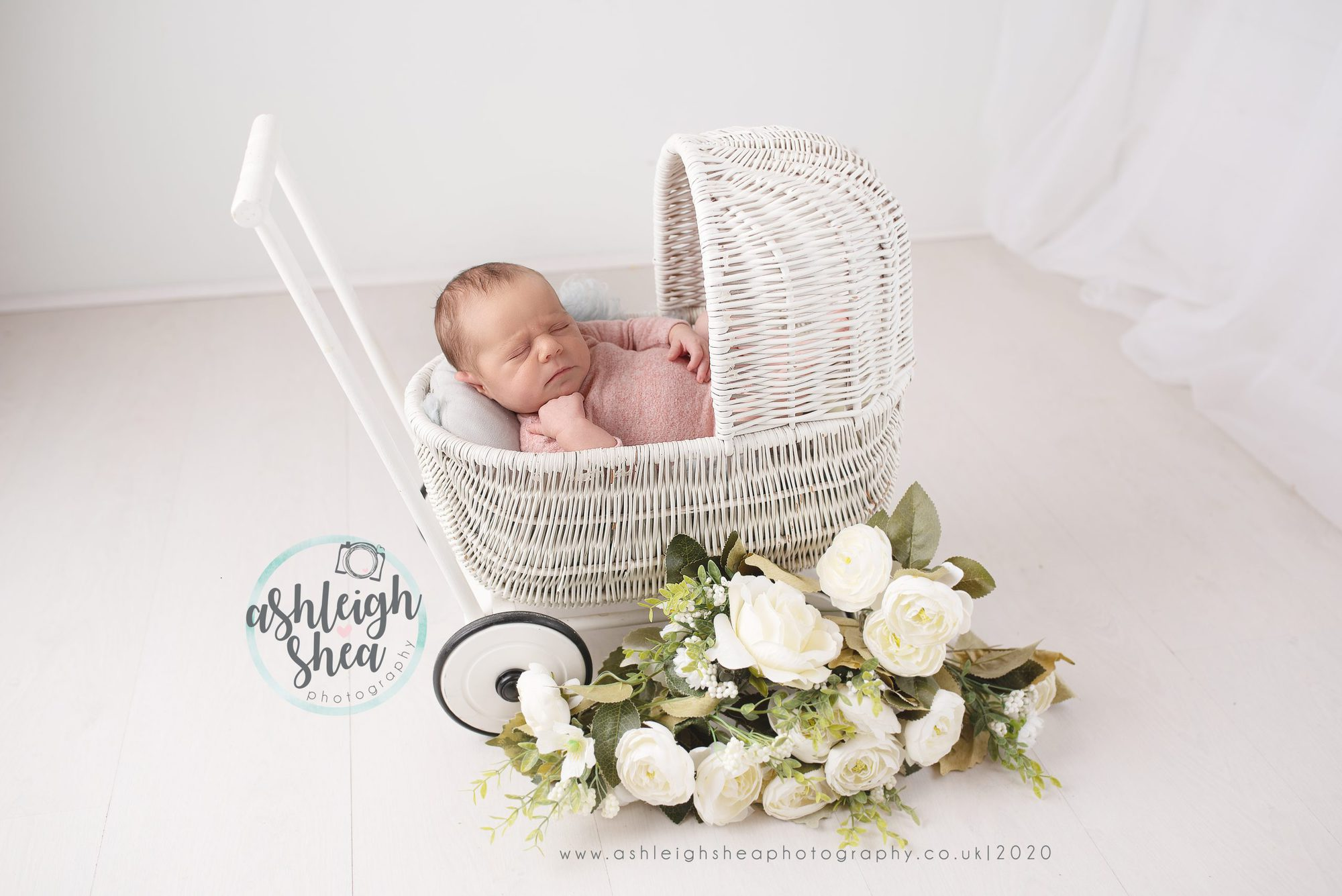 ashleigh shea photography, little pram, white flowers, pastel pink, baby girl, bexleyheath, london, wicker pram